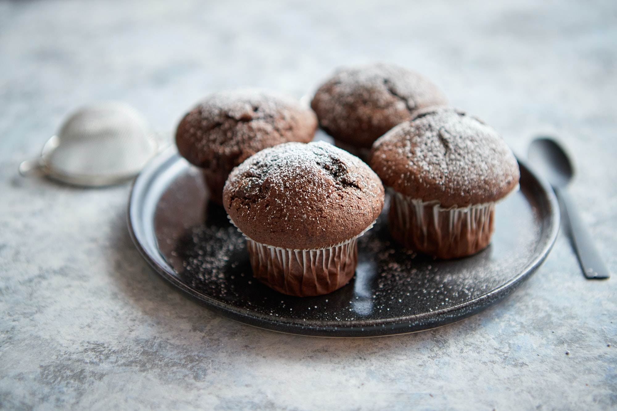 Fresh and tasty chocolate muffins served on plate